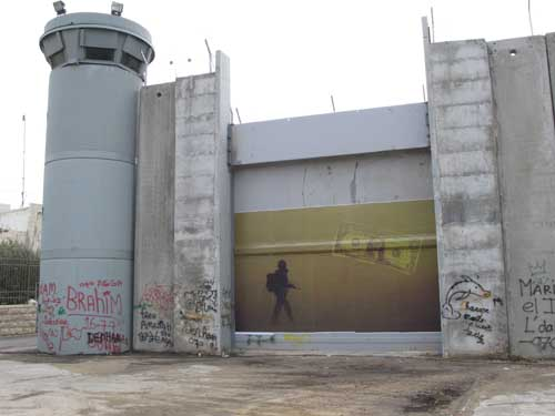 42. Who's Paying For This,print on separation wall in Bethlehem, Palestine,2007,KennardPhillipps