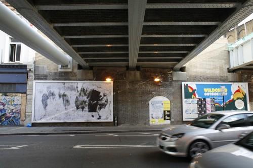 billboard under bridge on old street, london